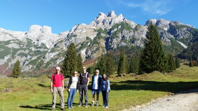 The Spatial Services team in front of an impressive mountain panorama